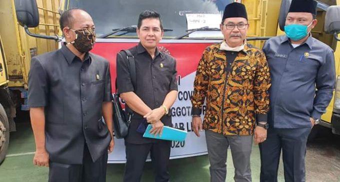 Reses, Anggota DPRD PALI Bagikan Paket Sembako dan Masker Kepada Warga
